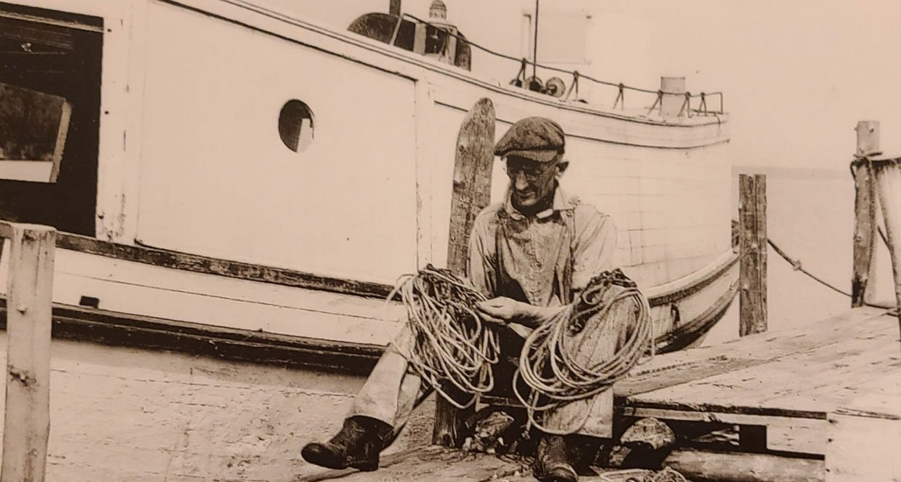 Ole Olson Untangling Rope on the Bayfield Waterfront