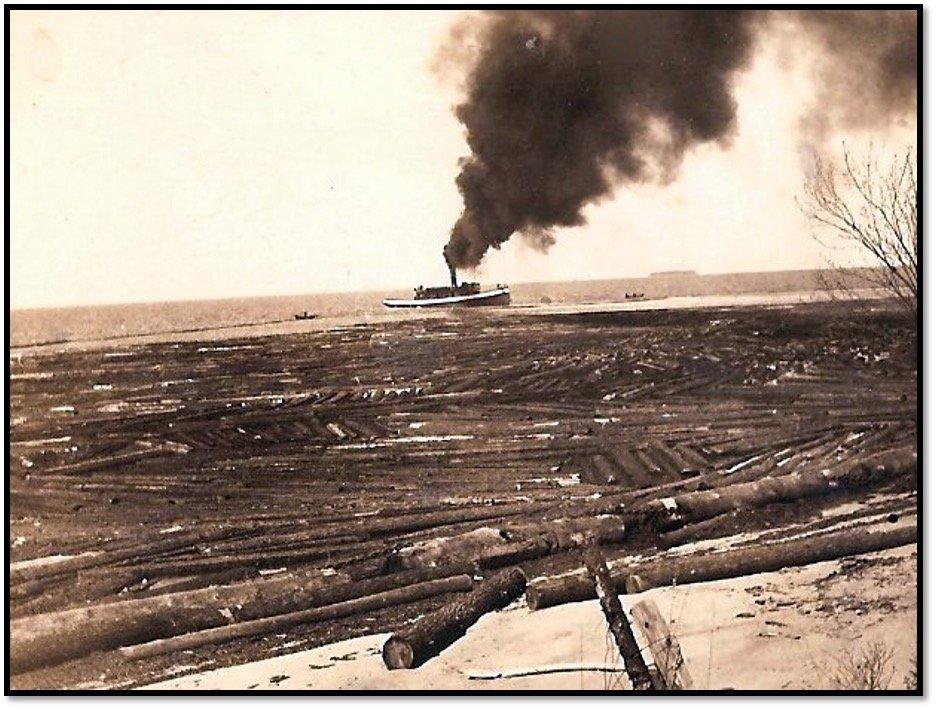 Tug Bayfield gathers the log boom near Cornucopia ca 1910