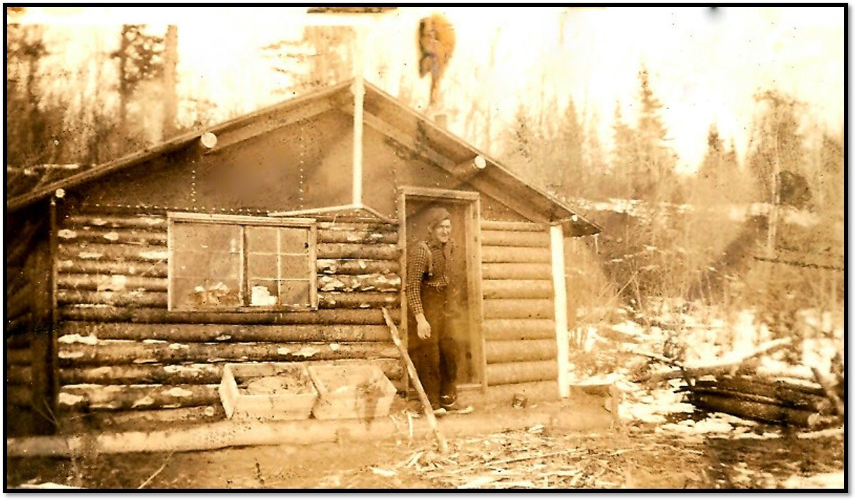 Wally Young at one of the remaining Oak Island Schroeder Lumber Cabins ca 1930s