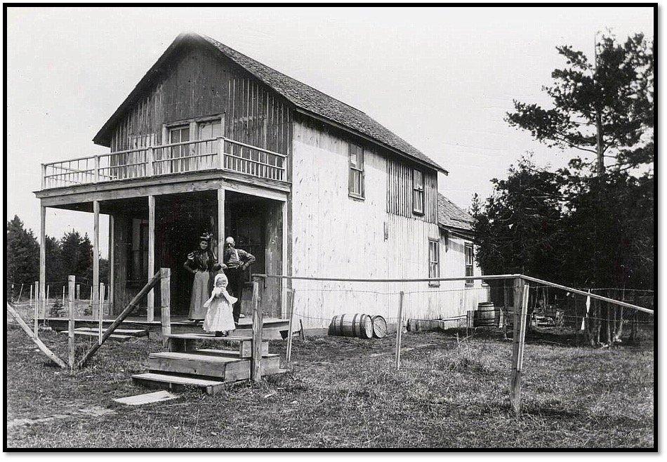 Frank Shaw home and small farm site near La Pointe Madeline Island ca 1900 Anna Mae Shaw-Hill - Frank Shaw and child- Millie Shaw Photo Burt Hill