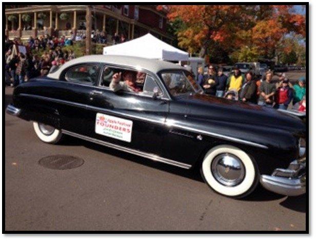 Applefest Parade-2014 Julian B Nelson with Jim Erickson driving Photo Heidi M Nelson